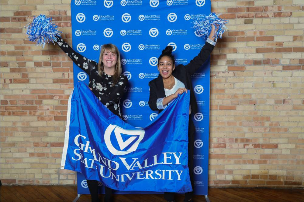 Lakers pose with GVSU banner